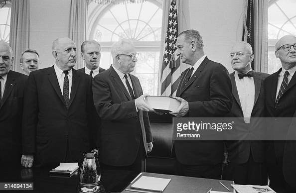 Chief Justice Earl Warren hands over to President Johnson his report on the Kennedy assassination The lengthy report submitted on September 24 was...