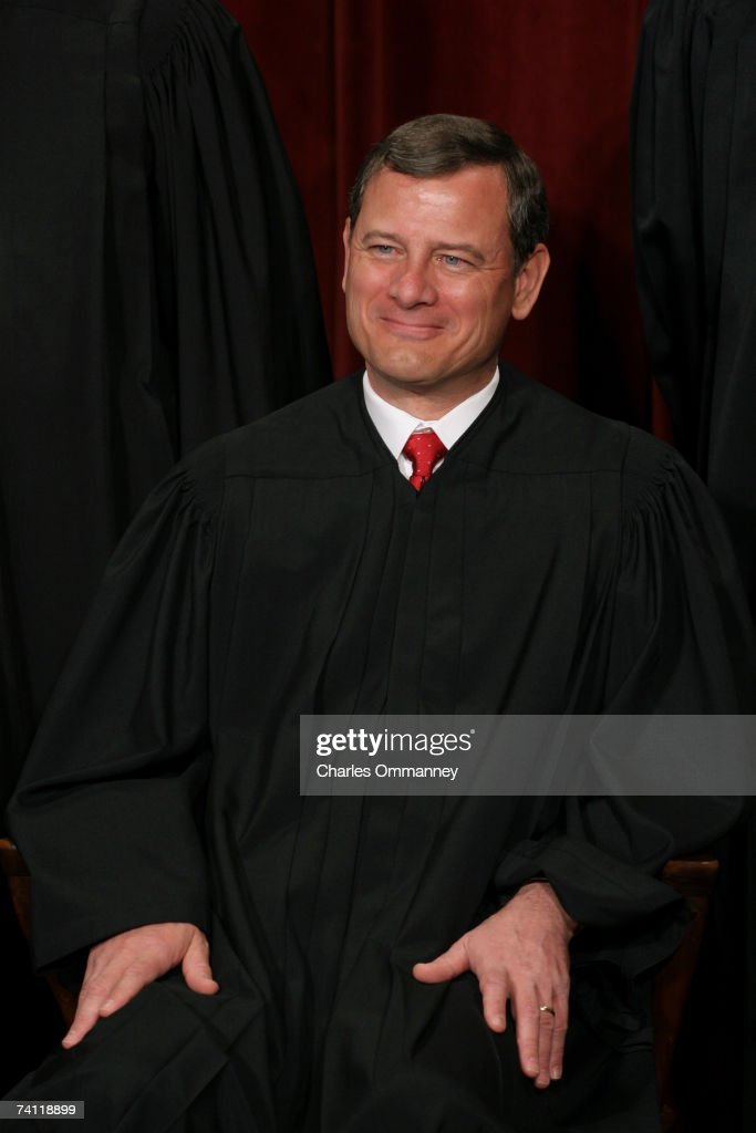 Chief Justice John G Roberts poses for photographers at the US Supreme Court October 31 2005 in Washington DC Earlier in the day US President George...