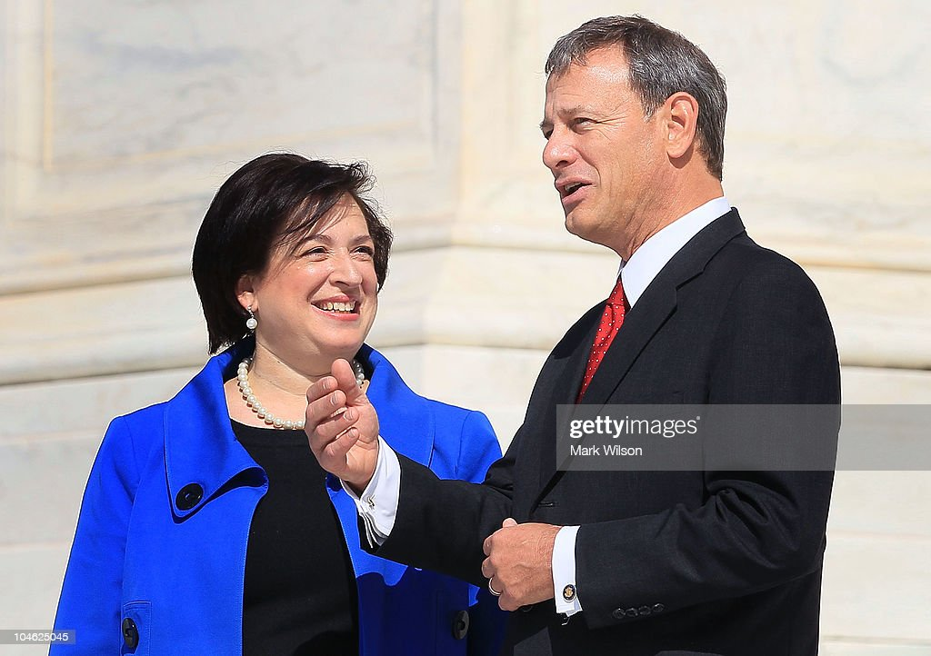 Chief Justice John Roberts and Associate Justice Elana Kagan stand in front of the US Supreme Court Building on October 1 2010 in Washington DC Chief...