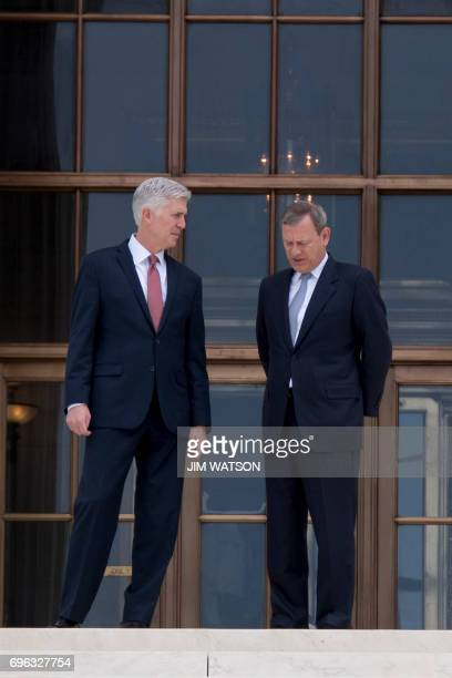 Chief Justice John Roberts and Justice Neil Gorsuch talk outside of the US Supreme Court in Washington DC June 15 2017 / AFP PHOTO / JIM WATSON