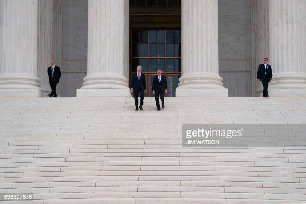 Chief Justice John Roberts and Justice Neil Gorsuch walk out of the US Supreme Court in Washington DC June 15 2017 / AFP PHOTO / JIM WATSON