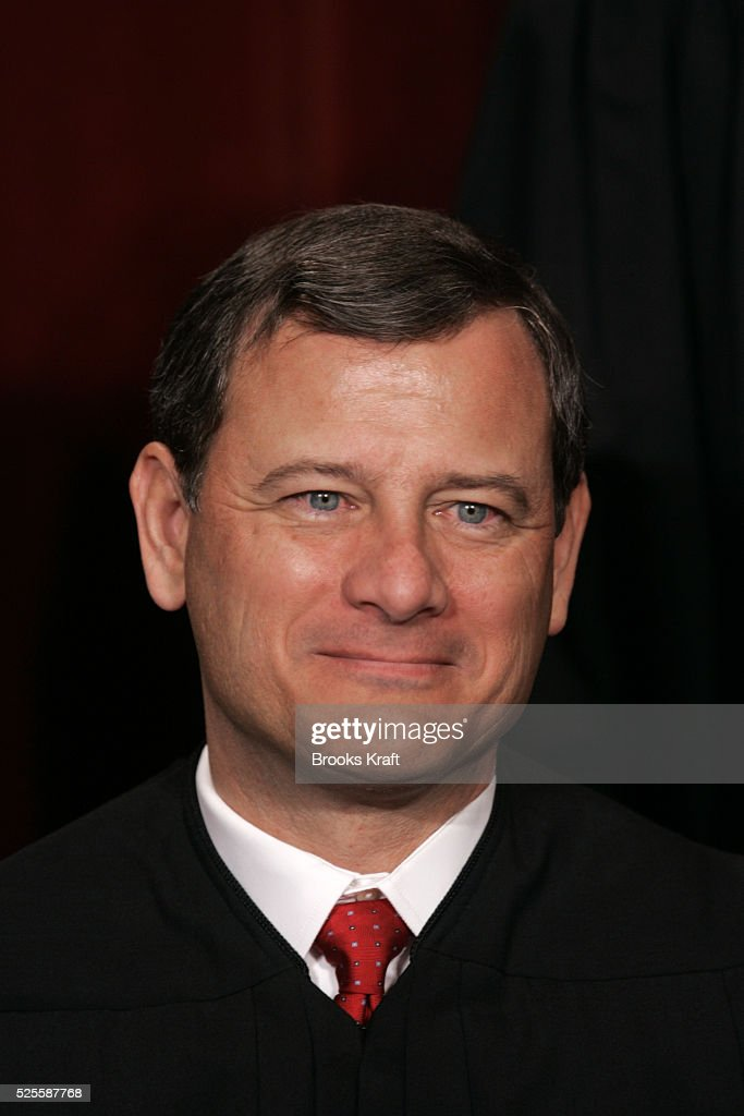 US Chief Justice John Roberts poses for an official picture with other justices at the US Supreme Court in Washington DC October 31 2005 Roberts...