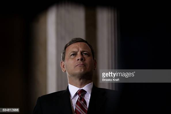 Chief Justice of the United States John Roberts waits to administers the oath of office for the new Treasury Secretary Henry Paulson at the US...