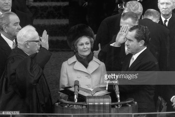 Chief Justice Warren Burger administers the oath of office for President Nixon during the 1969 inaugural ceremonies in Washington DC