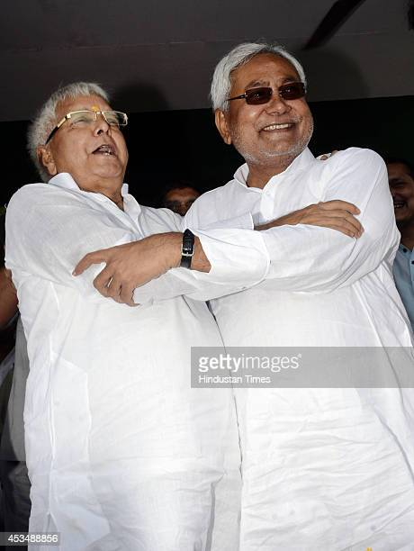 RJD chief Lalu Prasad and JD senior leader Nitish Kumar hugged each other on the dais at a joint election rally for assembly byelections at on August...