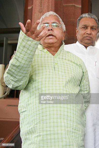 Chief Lalu Prasad Yadav addresses the media outside the parliament house in New Delhi on April 20 2010