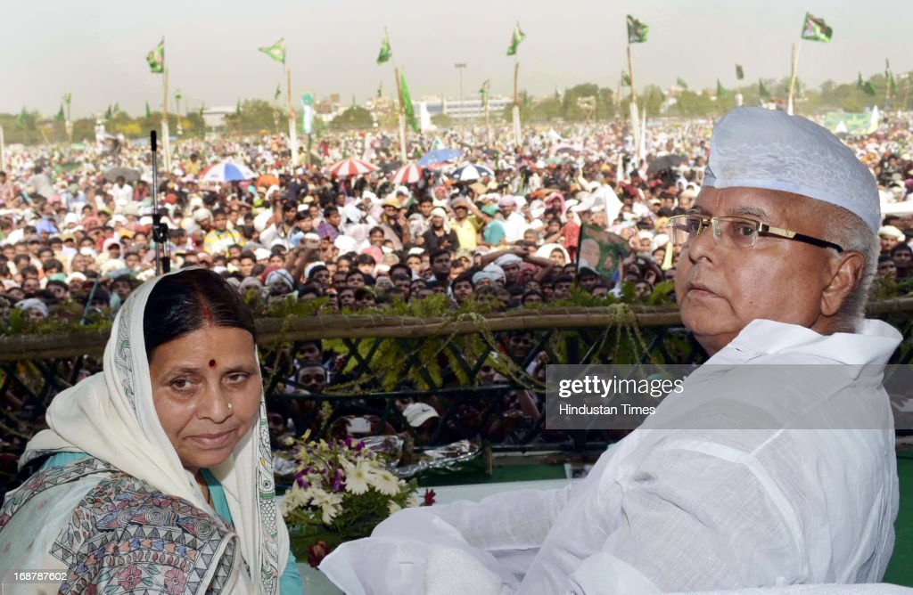 RJD Chief Lalu Prasad Yadav and his wife Rabri Devi at Parivartan Rally at Gandhi Maidan on May 15, 2013 in Patna, India. Addressing his first major rally in Bihar in a decade, 65 year old RJD supremo called Chief Minister Nitish Kumar a dictator.