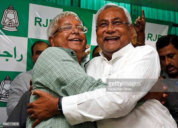 Chief Lalu Prasad Yadav and Nitish Kumar celebrate after Mahagathbandhan's victory in Bihar assembly elections at RJD office on November 8 2015 in...