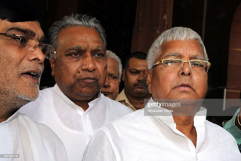RJD Chief Lalu Prasad Yadav and other MP's leave Parliament House after attending Parliament Budget Session on March 20, 2013 in New Delhi, India.