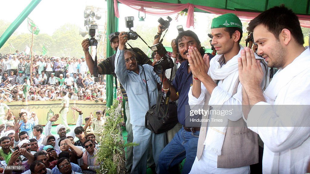 RJD Chief Lalu Prasad Yadav and Rabri Devi's sons Tej Pratap and Tejashwi Yadav (L) at Parivartan Rally at Gandhi Maidan on May 15, 2013 in Patna, India. Addressing his first major rally in Bihar in a decade, 65 year old RJD supremo called Chief Minister Nitish Kumar a dictator.