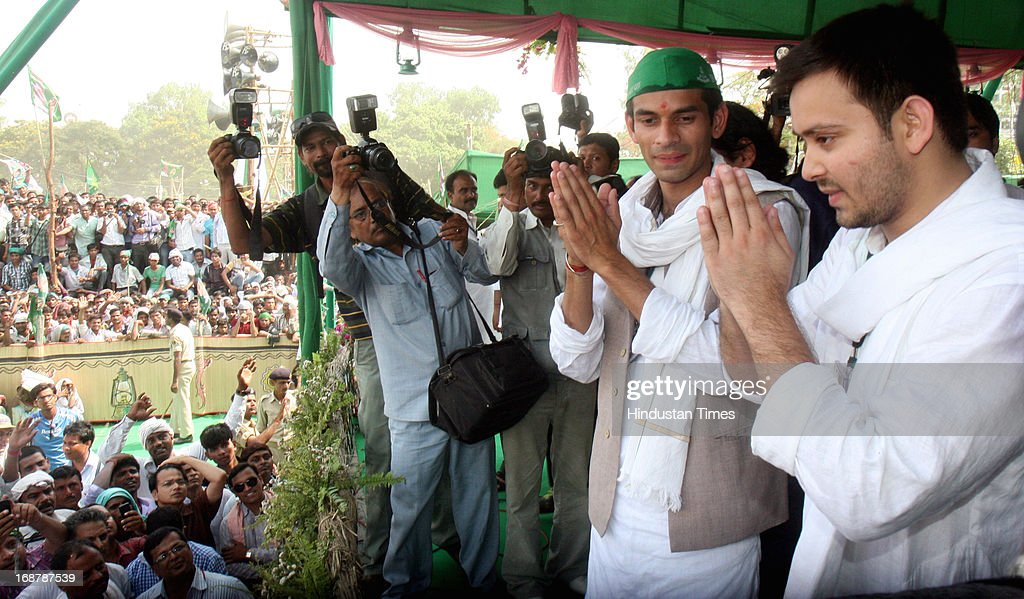 RJD Chief Lalu Prasad Yadav and Rabri Devi's sons Tej Pratap (L) and Tejashwi Yadav (R) at Parivartan Rally at Gandhi Maidan on May 15, 2013 in Patna, India. Addressing his first major rally in Bihar in a decade, 65 year old RJD supremo called Chief Minister Nitish Kumar a dictator.