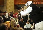 Chief Lalu Prasad Yadav blessing his soninlaw Tej Pratap while Mulayam Singh Yadav looks on as the baraat arrives for the wedding at Ashoka Hotel on...