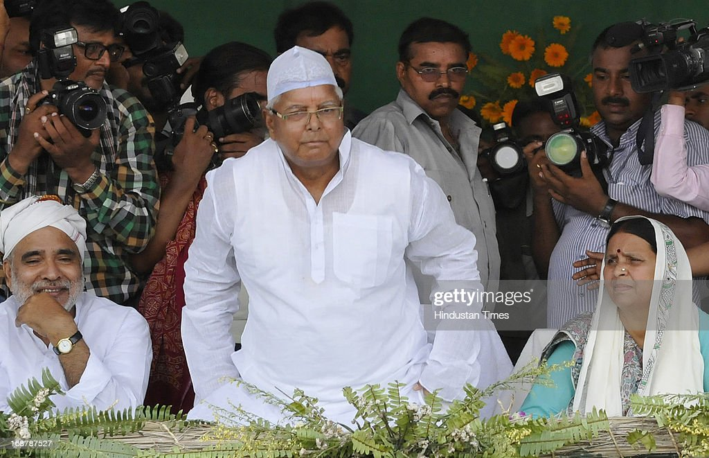 RJD Chief Lalu Prasad Yadav, his wife Rabri Devi and senior RJD leader Raghuvansh Prasad Singh at party's Parivartan Rally at Gandhi Maidan on May 15, 2013 in Patna, India. Addressing his first major rally in Bihar in a decade, 65 year old RJD supremo called Chief Minister Nitish Kumar a dictator.
