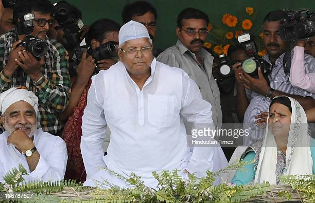 Chief Lalu Prasad Yadav his wife Rabri Devi and senior RJD leader Raghuvansh Prasad Singh at party's Parivartan Rally at Gandhi Maidan on May 15 2013...