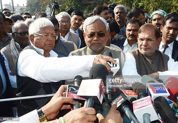 RJD chief Lalu Prasad Yadav JD senior leader Nitish Kumar and JD president Sharad Yadav addressing a media after meeting Bihar Governor Keshari Nath...