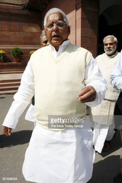 RJD chief Lalu Prasad Yadav walks out from Parliament at the time of Budget presentation on February 26 2010 in New Delhi