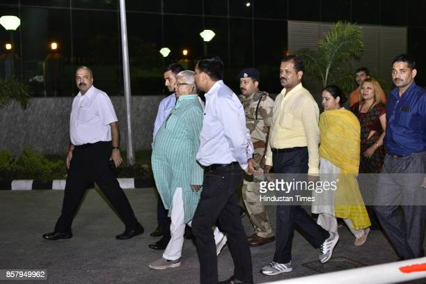 Chief Lalu Yadav and his daughter Misa Bharti at CBI headcounter on October 5 2017 in New Delhi India Bihar politician Lalu Yadav was questioned for...