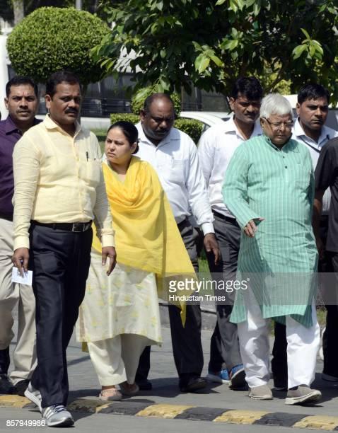 Chief Lalu Yadav and his daughter Misa Bharti at CBI headquarter on October 5 2017 in New Delhi India Bihar politician Lalu Yadav was questioned for...