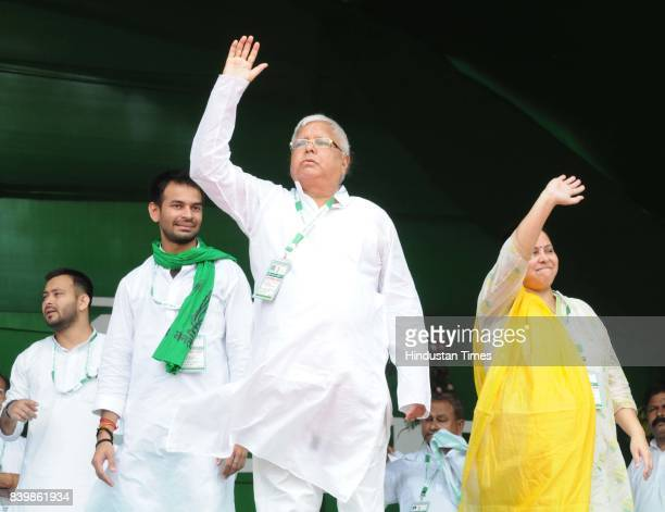 Chief Lalu Yadav with his children at mega rally 'BJP Bhagao Desh Bachao' organised by Rashtriya Janata Dal at Gandhi Maidan on August 27 2017 in...