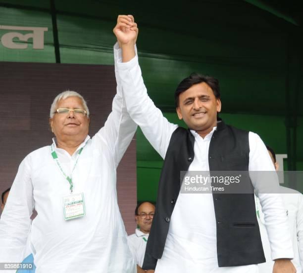 Chief Lalu Yadav with SP Chief Akhilesh Yadav at mega rally 'BJP Bhagao Desh Bachao' organised by Rashtriya Janata Dal at Gandhi Maidan on August 27...
