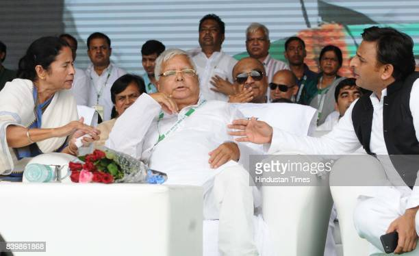 Chief Lalu Yadav with West Bangal Chief Minister Mamata Banerjee and SP Chief Akhilesh Yadav at mega rally 'BJP Bhagao Desh Bachao' organised by...