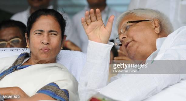 Chief Lalu Yadav with West Bangal Chief Minister Mamata Banerjee at mega rally 'BJP Bhagao Desh Bachao' organised by Rashtriya Janata Dal at Gandhi...