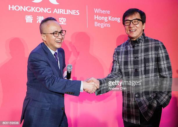 Chief Marketing Officer of Hong Kong Airlines George Liu handshakes with actor martial artist Jackie Chan during the media QA session at Fairmont...