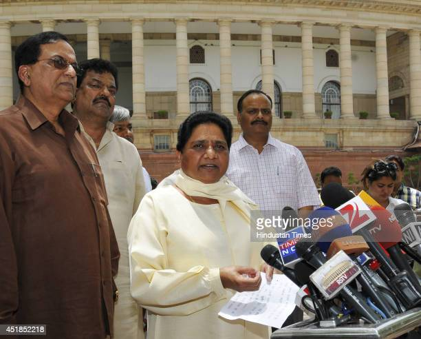 Chief Mayawati talking to media person at Parliament House after presentation of Rail Budget 201415 on July 8 2014 in New Delhi India Indian Railway...