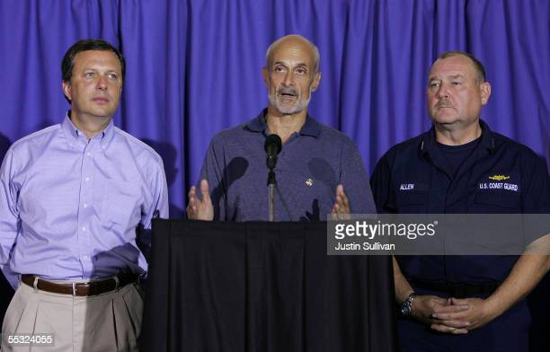 Chief Michael Brown and US Coast Guard Vice Admiral Thad Allen look on as Homeland Security Secretary Michael Chertoff speaks during a press...