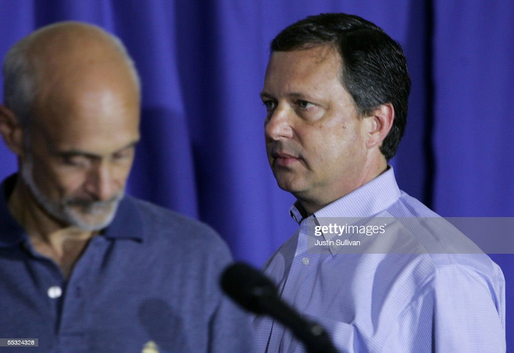 Chief Michael Brown looks on as Homeland Security Secretary <a gi-track='captionPersonalityLinkClicked' href=/galleries/search?phrase=Michael+Chertoff&family=editorial&specificpeople=204729 ng-click='$event.stopPropagation()'>Michael Chertoff</a> speaks during a press conference September 9, 2005 in Baton Rouge, Louisianna. FEMA Chief Michael Brown was removed from his role managing Hurricane Katrina and is being sent back to Washington D.C. and U.S. Coast Guard Vice Admiral Thad Allen will resume management of Katrina.