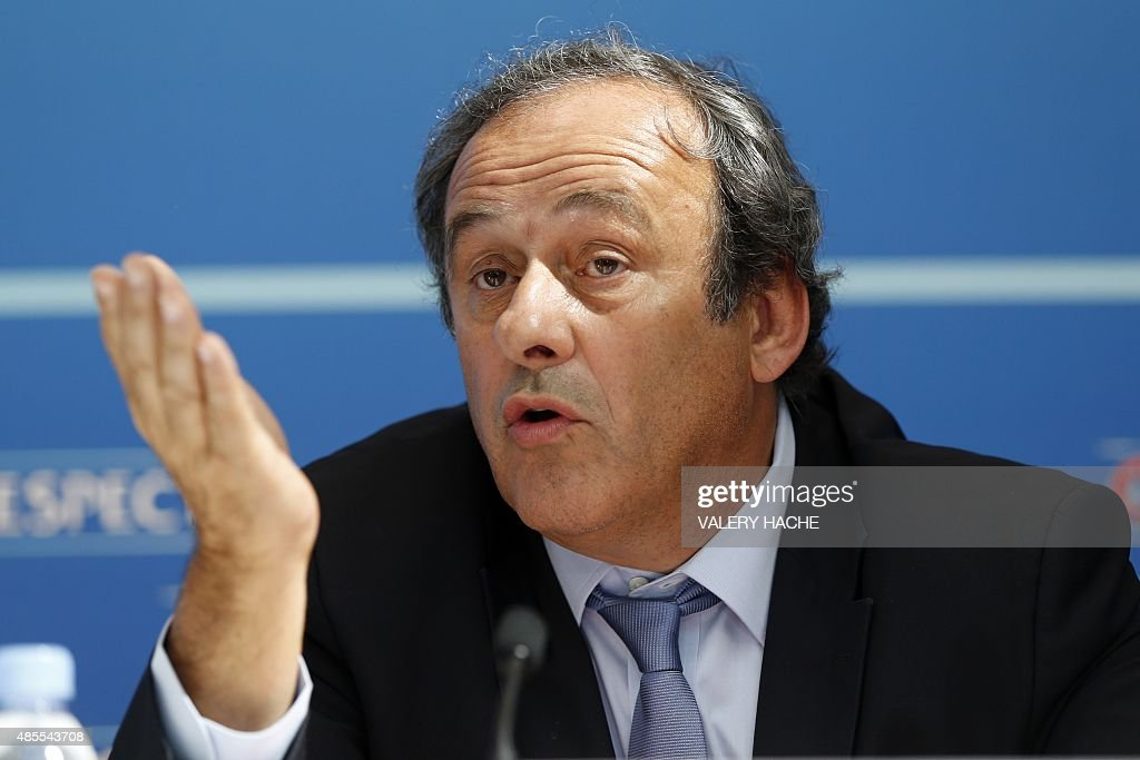 UEFA chief <a gi-track='captionPersonalityLinkClicked' href=/galleries/search?phrase=Michel+Platini&family=editorial&specificpeople=206862 ng-click='$event.stopPropagation()'>Michel Platini</a> gestures as he speaks during a UEFA press conference after the draw for the UEFA Europa League football group stage 2015/16 on August 28, 2015 in Monaco. AFP PHOTO / VALERY HACHE