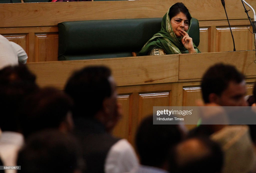 Chief minister Mehbooba Mufti observes while opposition MLAs protest during Jammu And Kashmir assembly session on May 27, 2016 in Srinagar, India.