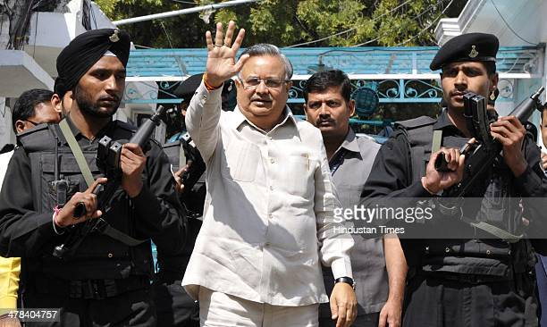 Chief Minister of Chhattisgarh Raman Singh gestures as he arrives to attend a party's Central Election Committee meeting at BHP HQ on March 13 2014...