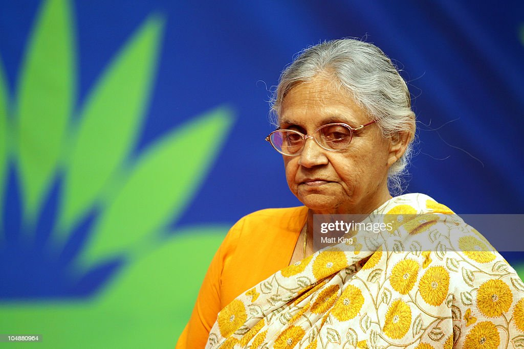 Chief Minister of Delhi, <a gi-track='captionPersonalityLinkClicked' href=/galleries/search?phrase=Sheila+Dikshit&family=editorial&specificpeople=728110 ng-click='$event.stopPropagation()'>Sheila Dikshit</a> attends the medal ceremony for the Women's 100m Freestyle Final at the Dr. S.P. Mukherjee Aquatics Complex during day three of the Delhi 2010 Commonwealth Games on October 6, 2010 in Delhi, India.