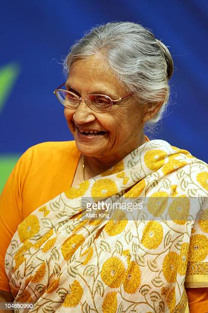 Chief Minister of Delhi Sheila Dikshit attends the medal ceremony for the Women's 100m Freestyle Final at the Dr SP Mukherjee Aquatics Complex during...