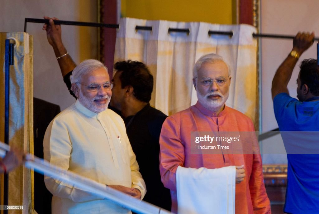 Chief Minister of Gujarat Narendra Modi during the function of unveils of his own wax statue at Leela Hotel, Andheri before BJP Maha Garjana Rally on December 22, 2013 in Mumbai, India. BJP President Rajnath Singh unveiled the statue before the two leaders proceeded for the rally.