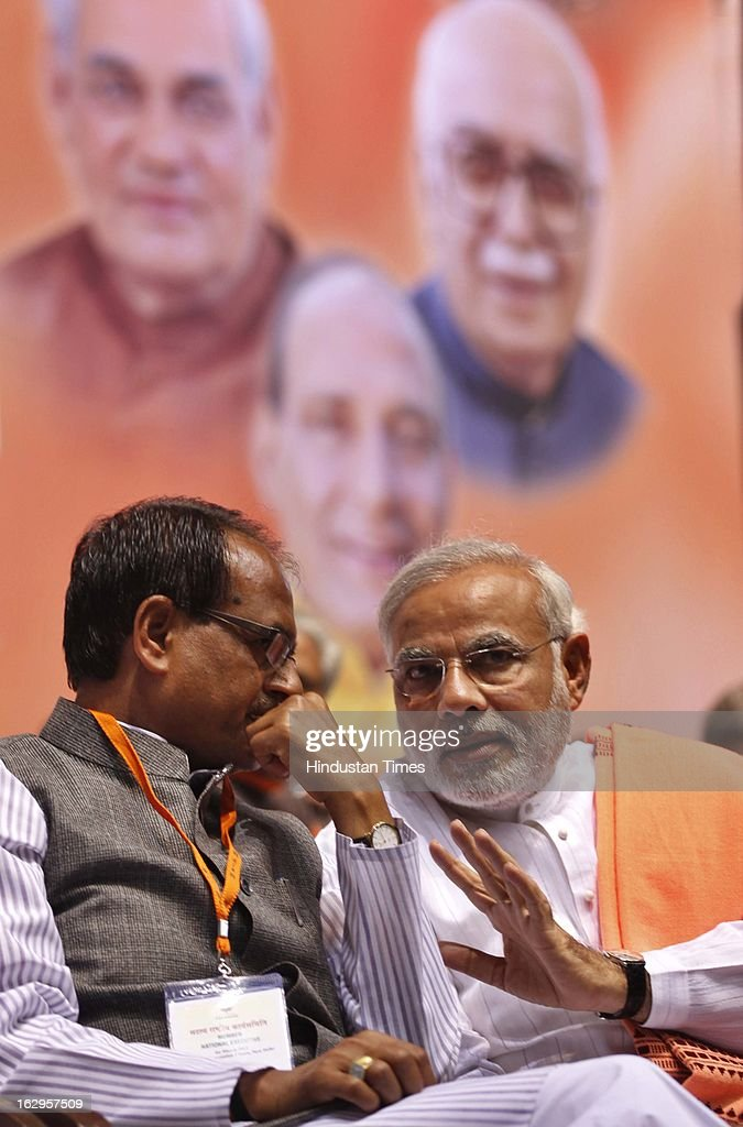 Chief Minister of Gujarat, Narendra Modi talking with Madhya Pradesh CM Shivraj Singh Chauhan during Bharatiya Janata Party National Council meeting at Talkatora Indoor Stadium on March 2, 2013 in New Delhi, India. In his 90 minute presidential address Rajnath Singh asked the party ranks to be prepared for early Lok Sabha polls and crucial assembly elections this year, including in Karnataka, Madhya Pradesh, Chhattisgarh, Rajasthan and Delhi all very important states for BJP.