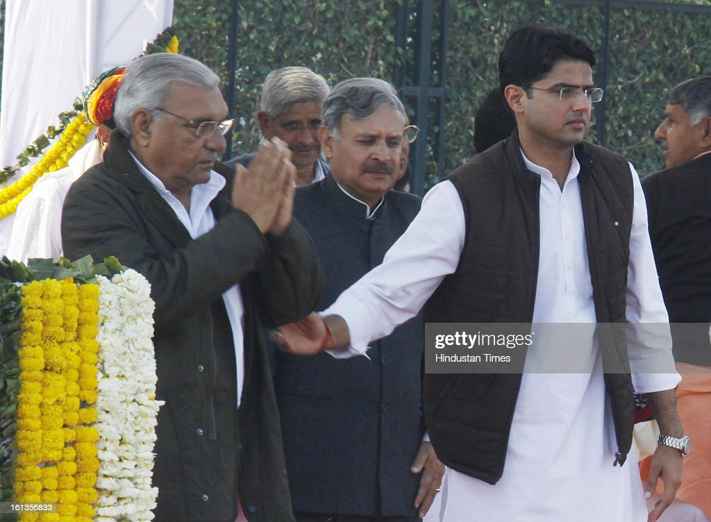 """Chief minister of Haryana Bhupender Singh Hooda and Corporate Affairs minister Sachin Pilot at Kisan Sammelan on the occasion of late Rajesh Pilot's 68th birth anniversary on February 10, 2013 in Gurgaon, India. Sachin Pilot listed the """"pro-farmer and pro-people"""" initiatives taken by the Congress-led coalition in the past eight years."""