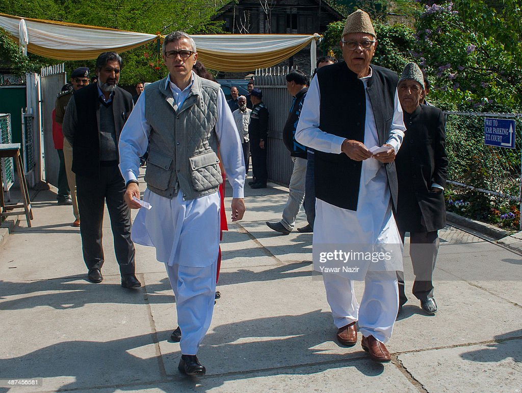 Chief Minister of Jammu and Kashmir Omar Abdullah (L), and president of the National Conference (NC) party, Kashmir's ruling party With his father <a gi-track='captionPersonalityLinkClicked' href=/galleries/search?phrase=Farooq+Abdullah&family=editorial&specificpeople=2291127 ng-click='$event.stopPropagation()'>Farooq Abdullah</a> a minister in the Indian government and patron of the pro-India National Conference (NC) party walk towards a polling station to cast their votes during the seventh phase of Indian parliamentary elections on April 30, 2014 in Budgam, west of Srinagar, the summer capital of Indian-administered Kashmir, India. Despite the crackdown and detention of more than 600 Kashmir youth ahead of Wednesday's second round of polls for Indian parliament in Kashmir voting remained sluggish in cities, towns and many villages. But in few places the turn out was over 50 per cent. Large numbers of Indian troops were deployed on the streets of Kashmir to thwart protest as the dissent politicians had asked people to stay away from elections and called for complete shutdown. Polling stations remained under tight security in the seventh phase of Indian parliamentary elections with only 26 per cent voters turning out to use their franchise. In Old City of Srinagar a youth was shot dead by Indian armed forces during protests in the evening.