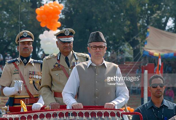 Chief Minister of Jammu and Kashmir Omar Abdullah receives guard of honor during India's Independence Day celebrations on August 15 2014 in Srinagar...