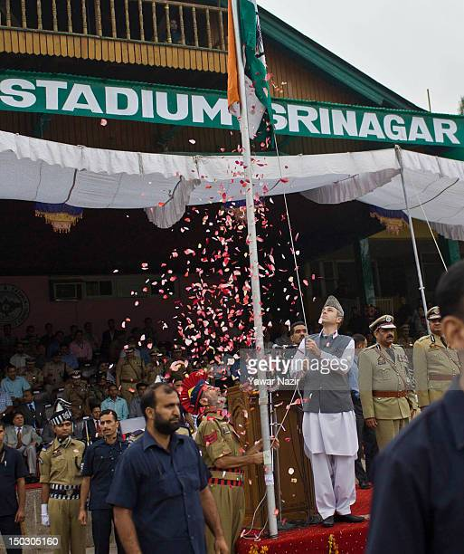 Chief Minister of Jammu and Kashmir Omar Abdullah unfurls an Indian national flag filled with flower petals during India's Independence Day...