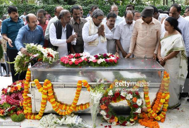 Chief Minister of Karnataka Siddaramaiah along with senior politicians from the state pay their respects next to her body at the Ravindra Kalakshetra...