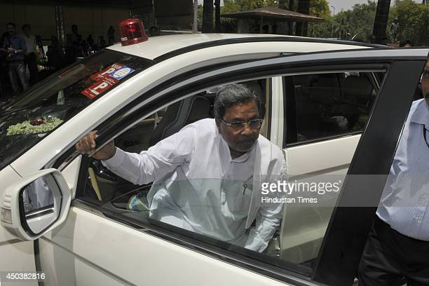 Chief Minister of Karnataka Siddaramaiah arrives at Parliament House to meet with Prime Minister Narendar Modi during the parliament session on June...