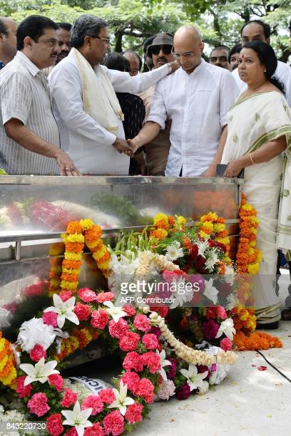 Chief Minister of Karnataka Siddaramaiah consoles Indrajit Lankesh the younger brother of Indian journalist Gauri Lankesh next to her body at the...