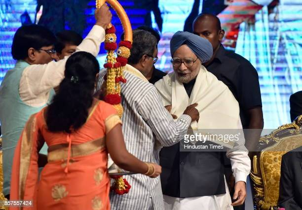 Chief Minister of Karnataka Siddaramaiah felicitates former Prime Minister of India Dr Manmohan Singh during the inauguration of academic session of...