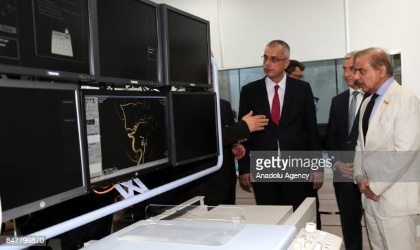 Chief Minister of Punjab Shehbaz Sharif is informed during his visit at Fatih Sultan Mehmet Training and Research Hospital as he is flanked by...