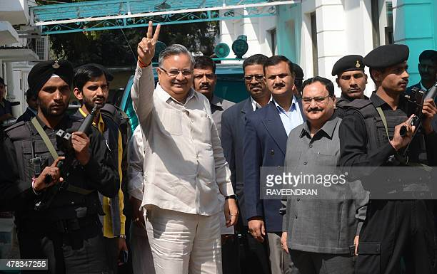 Chief Minister of the central Indian state of Chhattisgarh Raman Singh gestures as he arrives to attend a BJP Central Election Committee meeting in...