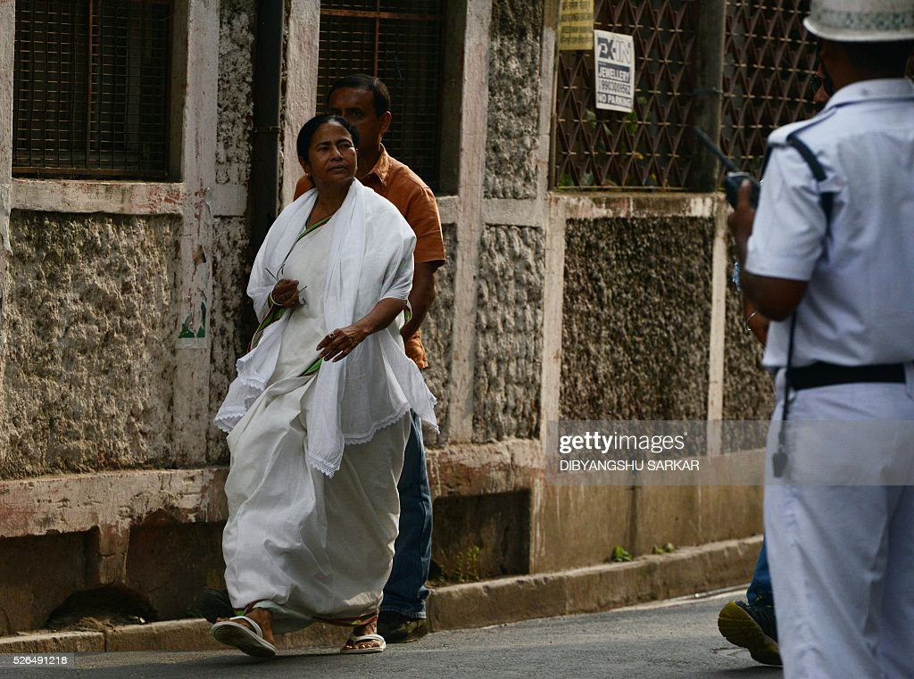 Chief minister of the eastern Indian state of West Bengal and Leader of the ruling Trinamool Congress(TMC) Mamata Banerjee, gestures as she arrives to cast her vote for state assembly elections at a polling station in Kolkata on April 30, 2016. State assembly elections in West Bengal are taking place from April 4 to May 5. / AFP / Dibyangshu SARKAR