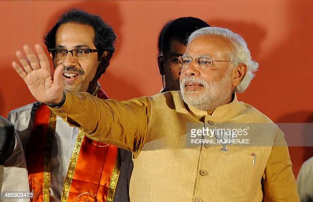 Chief Minister of the Indian state of Gujarat and Bharatiya Janata Party prime ministerial candidate Narendra Modi waves to supporters as Shiv Sena...