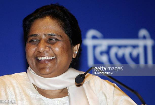 Chief Minister of the Indian state of Uttar Pradesh and President of the Bahujan Samaj Party Mayawati smiles as she addresses a press conference in...